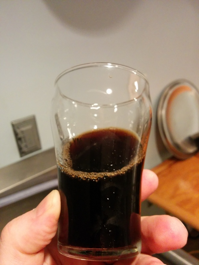Tasting the hydrometer sample. Look at that beautiful dark brown colour!